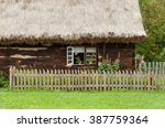 Wooden Cottage In Village In...
