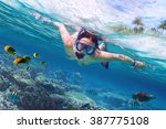 beautiful women snorkeling in... | Shutterstock . vector #387775108