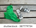 t shirt and sandals on a dock | Shutterstock . vector #387779734