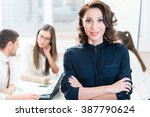 manager with her team working... | Shutterstock . vector #387790624