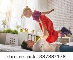 mother and her child girl... | Shutterstock . vector #387882178
