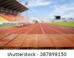 wood table top on blurred... | Shutterstock . vector #387898150