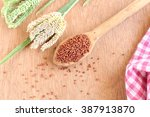 Small photo of Ragi or finger millet with its green and dried stalks on a wooden background.