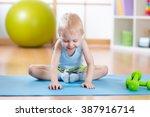 Happy Kid Boy Doing Gymnastics
