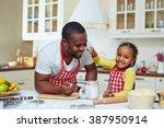 cute little girl cooking pastry ... | Shutterstock . vector #387950914
