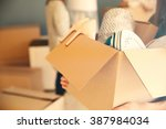 woman holding open cardboard... | Shutterstock . vector #387984034