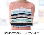 Woman Hold Clothes Pile  Close...