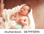 small baby girl sleeping on... | Shutterstock . vector #387995890