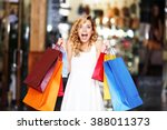 beautiful young woman with bags ... | Shutterstock . vector #388011373