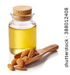 bottle of almond oil and wooden ... | Shutterstock . vector #388012408