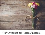 Small photo of Carnation flowers on wooden table
