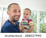 father and little cute son... | Shutterstock . vector #388027990