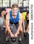 fitness class lifting dumbbells ... | Shutterstock . vector #388054750