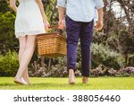 young couple walking in garden... | Shutterstock . vector #388056460