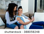 pregnant lesbian couple sitting ... | Shutterstock . vector #388058248