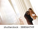 beautiful bridal couple... | Shutterstock . vector #388064749