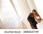 beautiful bridal couple... | Shutterstock . vector #388064749