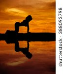 silhouette of a beautiful yoga... | Shutterstock . vector #388093798