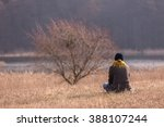 Young Woman Sitting On Grass O...