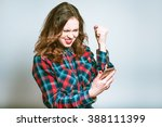 happy very excited woman... | Shutterstock . vector #388111399