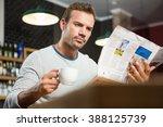 handsome man reading newspaper... | Shutterstock . vector #388125739