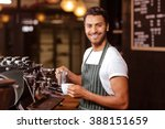 handsome waiter adding milk to... | Shutterstock . vector #388151659