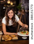 pretty waitress behind the... | Shutterstock . vector #388151773