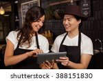 smiling co workers using tablet ... | Shutterstock . vector #388151830