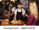 smiling waiter serving a coffee ... | Shutterstock . vector #388151839