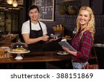 smiling barista taking credit... | Shutterstock . vector #388151869