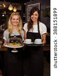 pretty waitresses posing in... | Shutterstock . vector #388151899
