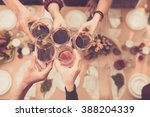 friends clinking glasses above... | Shutterstock . vector #388204339