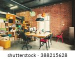 Small photo of Modern office Interior with old vintage brick Wall. Art work business space