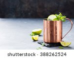 Small photo of Cold Moscow Mules cocktail with ginger beer, vodka, lime Grey stone background Copy space