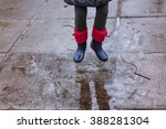 rain time.  jump in the puddle...   Shutterstock . vector #388281304