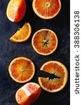 sliced sicilian blood oranges... | Shutterstock . vector #388306138