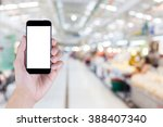 hand holding smart phone with... | Shutterstock . vector #388407340