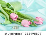 Two Rings And Tulips On A...
