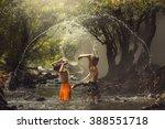 child splashing played in pond | Shutterstock . vector #388551718