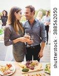 happy young friends having... | Shutterstock . vector #388562050