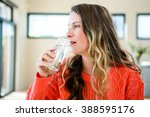 distracted woman drinking a... | Shutterstock . vector #388595176