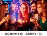woman blowing candles... | Shutterstock . vector #388599490
