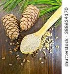 cedar flour in a wooden spoon ... | Shutterstock . vector #388634170