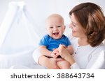 young mother holding her... | Shutterstock . vector #388643734
