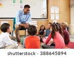 elementary school kids sitting...   Shutterstock . vector #388645894
