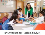 teacher teaching elementary...   Shutterstock . vector #388655224