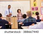 schoolgirl presenting to her... | Shutterstock . vector #388667440