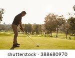 male golfer lining up tee shot... | Shutterstock . vector #388680970