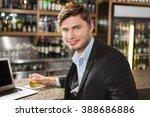 handsome man having a drink in... | Shutterstock . vector #388686886