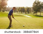 male golfer lining up tee shot... | Shutterstock . vector #388687864